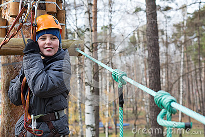 Climber is ready to the passage the ropes course