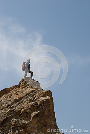 Climber stands at top