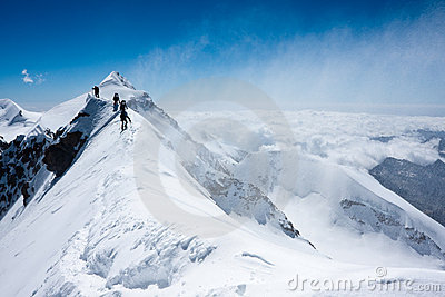 Climbers balancing in blizzard