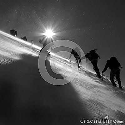 Climbers climbing the glacier