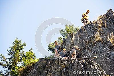 Climbers Climbing On Rock
