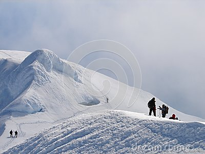 Climbers on edge of crater of volcano Beerenberg