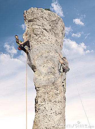Free Climbers In Action, Young Woman And Man Climbing. Stock Images - 40730074