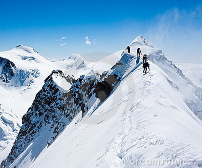 Climbers on a narrow ridge
