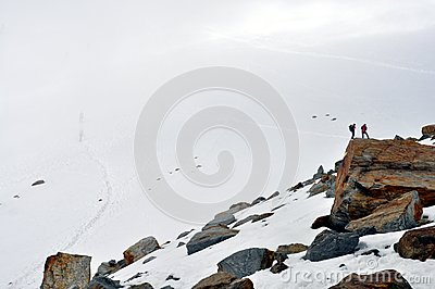 Climbers on a rock of a glacier Editorial Stock Photo
