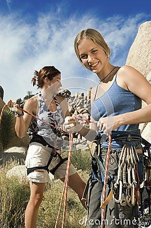Climbers Tying Ropes Before Climb