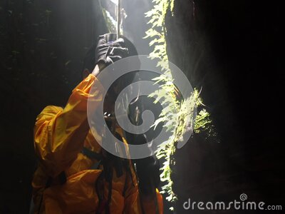 Climbers in uniform and abseiling in the cave stock footage