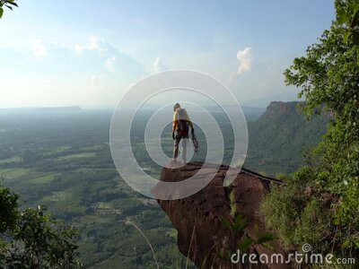 Climbers in uniform and abseiling in the Phu Lanka National park of Thailand stock video