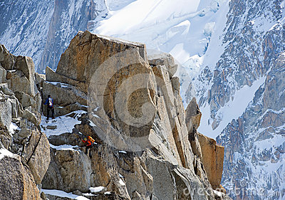 Climbing alpinists in Swiss Alps Editorial Image