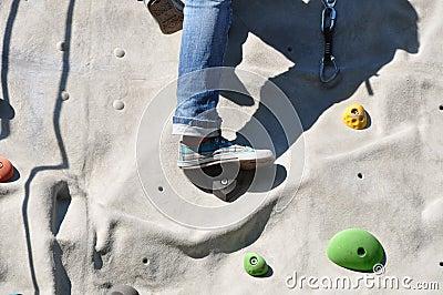 Climbing a boulder wall