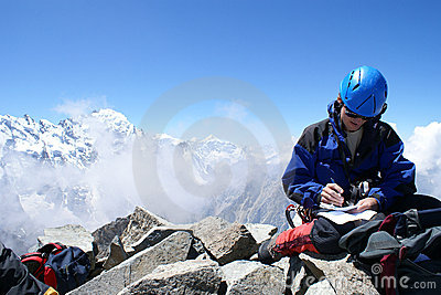 Climbing writes a message on the top of mountain