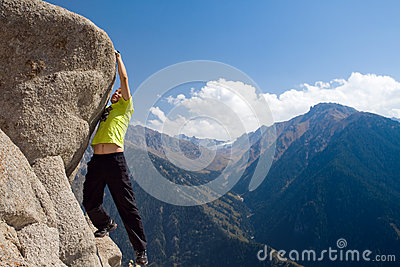 Climbing young adult at the top of summit