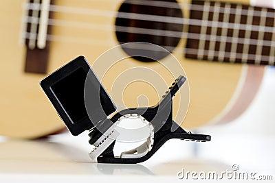 clip tuner equipment for tuning the ukulele guitar sound stock photo image 49853782. Black Bedroom Furniture Sets. Home Design Ideas