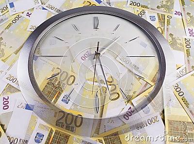 A clock and 200 euro banknotes