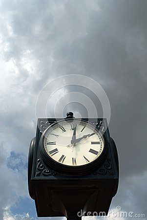 Clock Against Moody Sky