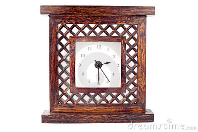 Clock in carved wood frame