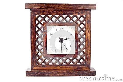 Clock in carved wood frame