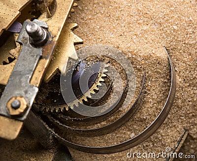 Clock gears in sand