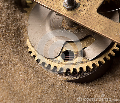 Clock gears in sand