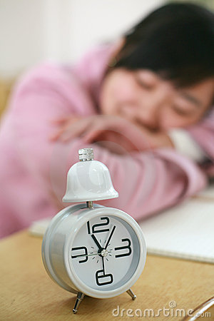 Clock with girl in class room
