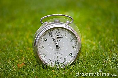 Clock on a grass