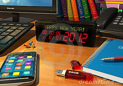 Clock with Happy New Year! message on table
