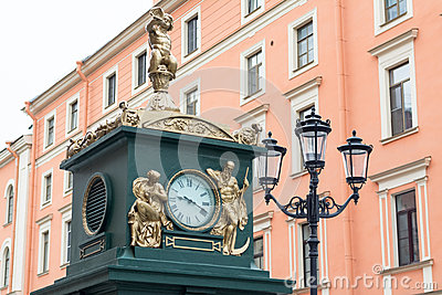 Clock and lamp in streets of St. Petersburg, Russia