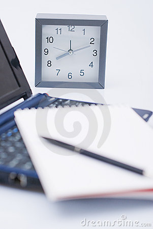 Clock and laptop with agenda