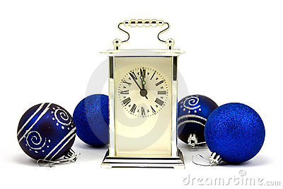 Clock showing five minutes to New Year