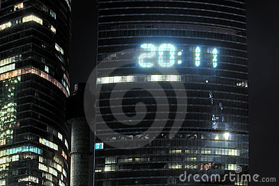 Clock on a skyscraper shows figures 2011