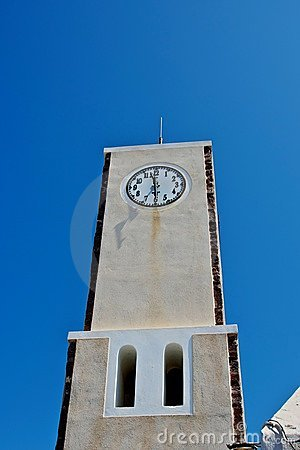 The clock on the tower.
