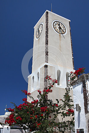 Clock tower on blue sky, Greece