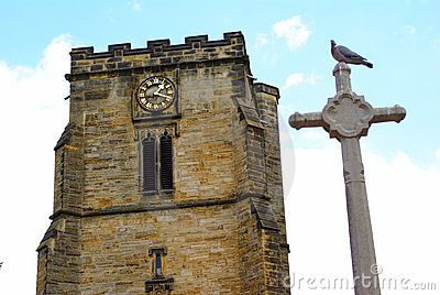 Clock tower of medieval cathedral with dove