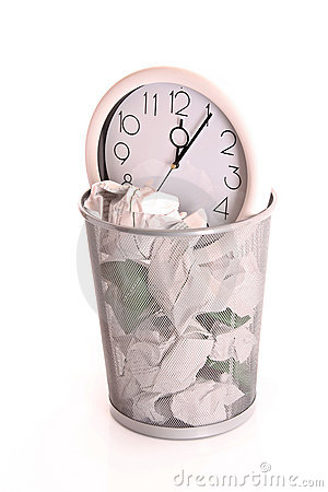 Clock in trash, lost time concept