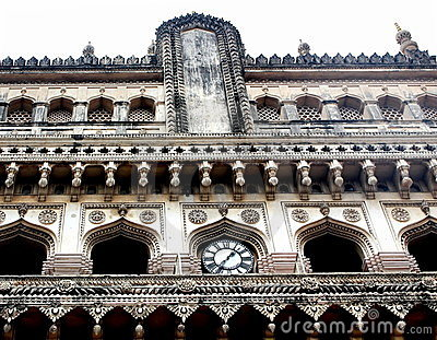 Clock on the wall of  Charminar, India