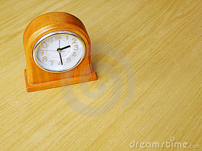 Clock on wood table