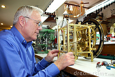 Clockmaker working on a clock
