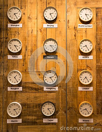 Free Clocks On A Wall With Time Zone Of Different Cities Stock Photo - 101246630