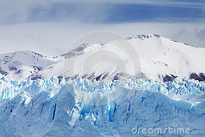 Cloeup of Glacier with Mountains in Background