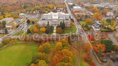 Capitol Building State House Augusta Maine Autumn Season Aerial. Close to the peak of fall color in the leaves at the State House of Main in Augusta USA stock footage