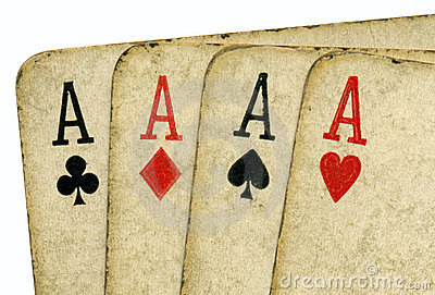 Close up 4 old vintage dirty aces poker cards.