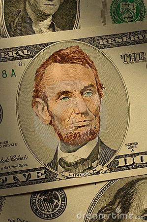 Close-up of Abraham Lincoln on the $5 bill