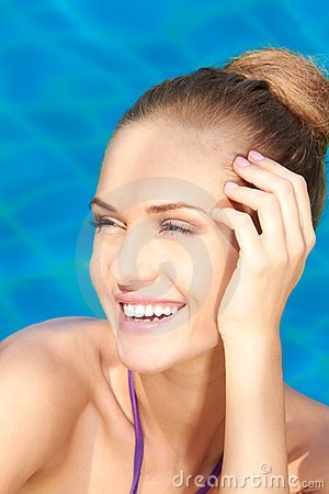 Close up of adorable woman in swimming pool