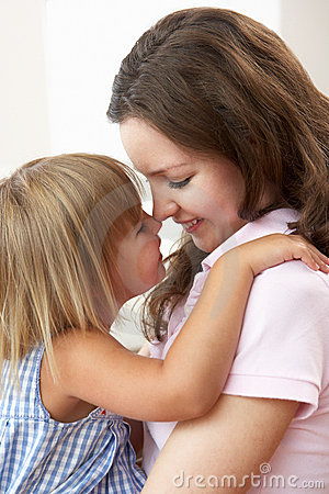 Close Up Of Affectionate Mother And Daughter At Ho