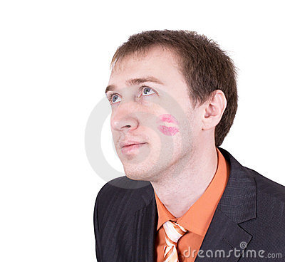 Close up of amazed kissed man face