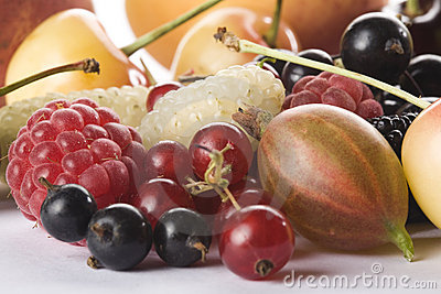 Close up of assorted summer berries and apricots