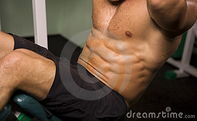 Close-up of an athletic man exercising