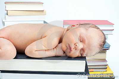 Close-up of baby sleep on the books