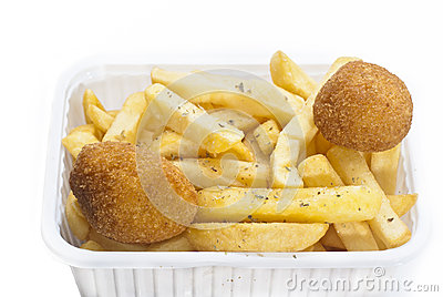 Close up of basket of fries and arancini
