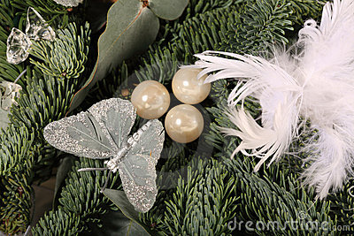 Close up of baubles and white feathers on a wreath